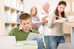 High school library - Student with book Stock Image