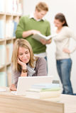 High school library - student with laptop Royalty Free Stock Photography