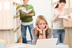High school library - student with laptop Royalty Free Stock Photo