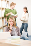 High school library - student with laptop Royalty Free Stock Photos