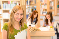 High school library teenage student in green Stock Photo