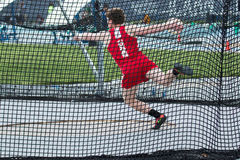 High school male discus thrower stock photo
