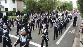 High school marching band performs in the parade. Beaverton, Oregon/USA - September 8 2018: Mountainside high school marching band performs in the Beaverton stock video