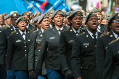 High School Military Cadets Sound Off At Veterans Day Parade Royalty Free Stock Photography