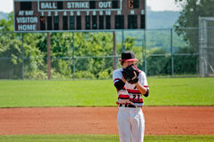 High school pitcher looking for signals  from catcher. Stock Images