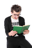 High school pupil is reading a book Stock Images