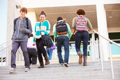 High School Pupils On Steps Outside Building Royalty Free Stock Images