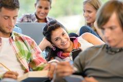 High-school pupils in study room music books