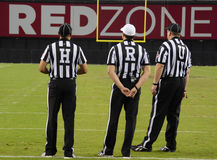 High School Referees. Waiting during a  time out Stock Photos