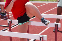 High school runner doing hurdle drills on a track Stock Photos