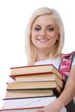 High school schoolgirl student with stack of books. Young blond Caucasian female college student holding huge pile of educational books from library Stock Photos