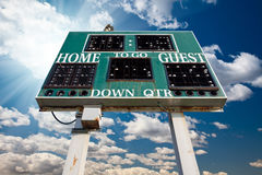 High School Scoreboard Over Blue Sky with Clouds Royalty Free Stock Photos