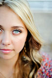 High School Senior Close Up Cropped Face. High school senior girl outdoors close up of face and blue eyes Stock Photography