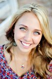 High School Senior Close Up Smiling Face. High school senior girl outdoors close up of face and blue eyes Royalty Free Stock Photography