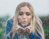 High school senior poses for portraits blowing glitter stock photography