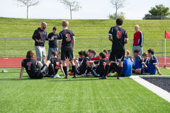 High School Soccer Coach speaks to his team. At halftime royalty free stock image