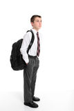 High school student carrying backpack bag stock image