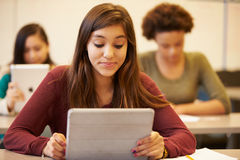 High School Student At Desk In Class Using Digital Tablet Stock Image