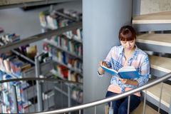 High school student girl reading book at library Stock Photography