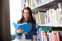 High school student girl reading book at library Stock Photo