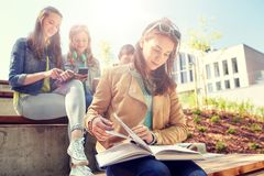 High school student girl reading book outdoors. Education, high school and people concept - high school student girl reading book outdoors Stock Photo