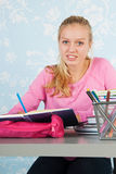 High school student with homework. High school student making homework at desk royalty free stock photo
