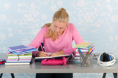 High school student with homework. High school student making homework at desk royalty free stock photos