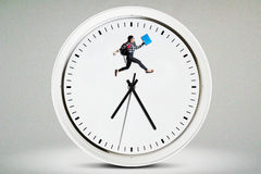 High school student jumping on the clock Stock Images