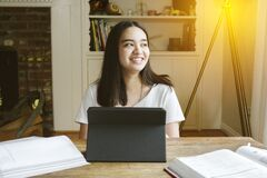 High School Student Learns from Home During Pandemic - Tablet Laptop - Home School - Living Room - Smiling Female