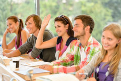 High-school student raising her hand in class royalty free stock image