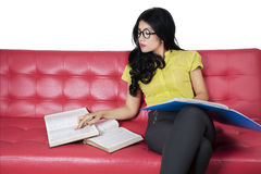 High school student reading books on the couch Stock Photos