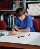 High School Student Studying In Library Stock Photo