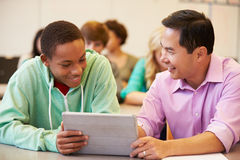 High School Student With Teacher Using Digital Tablet stock photography