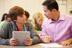 High School Student With Teacher Using Digital Tablet Stock Photo