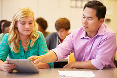 High School Student With Teacher Using Digital Tablet Royalty Free Stock Images