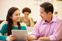 High School Student And Teacher Using Digital Tablet Stock Photography