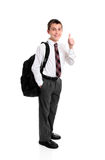 High school student thumbs up hand sign. High school boy standing in uniform showing a thumbs up hand sign, eg success, approval, great, etc Royalty Free Stock Photo