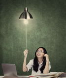 High school student turn on a lightbulb Stock Photo
