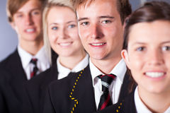 High school students. Group of high school students in uniforms closeup portrait stock image