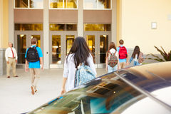 High School Students Being Dropped Off At School By Parents Stock Photography