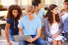 High School Students Collaborating On Project On Campus Royalty Free Stock Image