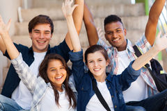 High school students. Excited high school students with arms outstretched outdoors stock photography
