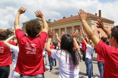 High school students at the graduate parade with hands up. After the graduate parade, during the quadrille dance at the end of high school in the main town Royalty Free Stock Photos