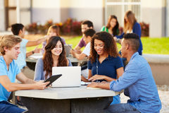 High School Students Hanging Out On Campus Stock Images