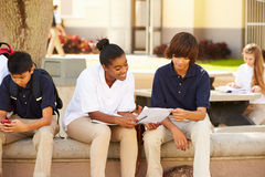 High School Students Hanging Out On School Campus Stock Image