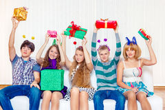 High school students hold present boxes Royalty Free Stock Photography