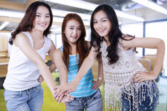 High school students joining hands Royalty Free Stock Photo