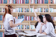 High school students learning in library Stock Images