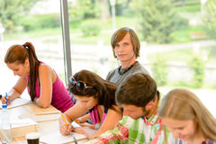 High-school students at lesson in class teens. College writing young Stock Photos