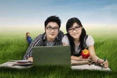 High school students lying on grass Royalty Free Stock Photos